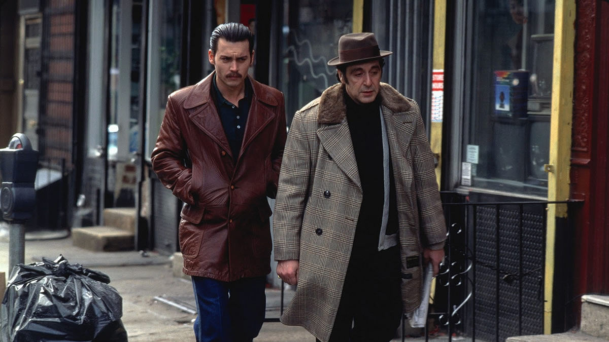 a review of donnie brasco a mobster movie by mike newell Directed by mike newell - a change of pace from four weddings and a funeral - it's pitched midway between the epic godfather and the flash goodfellas, and summary fact-based crime drama about an fbi agent who goes undercover in the mafia and becomes the protege of a gangster however, the demands of his.